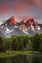 Teton range at sunset by Ron Niebrugge: At the top of this picture, bright clouds, below that, Teton peaks, below that, forest and in the foreground, water. used with permission from the photographer, Ron Niebrugge