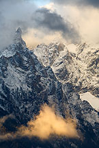grand teton with bright cloud by Ron Niebrugge: snowy grand teton peak a with bright cloud in the lower foreground, used with permission from the photographer, Ron Niebrugge
