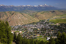 almost aerial of jackson, wyoming by Ron Niebrugge: the city of jackson, wyoming taken from a nearby peak, with the teton range just visible beyond a bluff overlooking the town. used with permission from the photographer, Ron Niebrugge