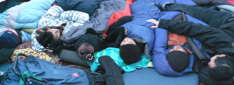 2009 group asleep in tent 120 pixels: 2009 group asleep in tent with large stuffed bear