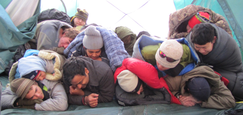 2010 snow camp group sleeping 236 pxls: 12 people in sleeping bags piled on top of each other inthree rows in an eight person tent