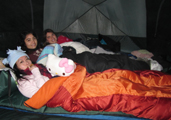 3 girls in tent winter 2011: 3 smiling girls in their sleeping bags in a tent