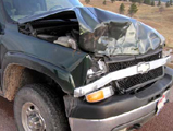 NPS photo Chevy after collision with a bison: NPS photo Chevy with front end damage after collision with a bison.