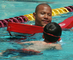 Ray Alvin at Silicon Valley kids triathlon: lifeguard Ray Alvin swimming with a kid at Silicon Valley kids triathlon