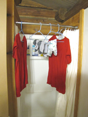 laundry on hangers in shower: shirts and socks on hangers in shower