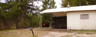 colter bay tent cabin: canvas walled cabin with wood sides showing the patio