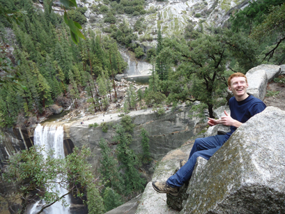 Darrell Vaughn at Clark's Point above Vernal Fall in Yosemite photo by Thuy Tien Nguyen: man sitting on edge of cliff above a waterfall