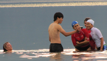 ethan peter phung kelly and christina in lake: sitting on a log or standing in a lake after swimming