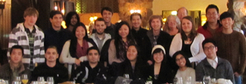 group photo brunch 2014 120 pixels: people standing behind and sitting at a dining table at the Ahwahnee hotel, Feb. 2014