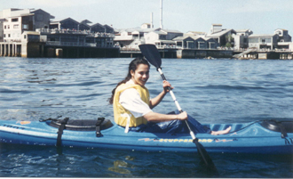 kayak with Monterey Bay Aquarium in background: