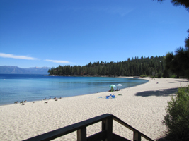 meeks bay beach: sandy beach on Lake Tahoe with a bit of a deck in the foreground