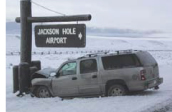 nps photo SUV hit sign: nps photo snowy road, SUV with a crumpled hood hit sign