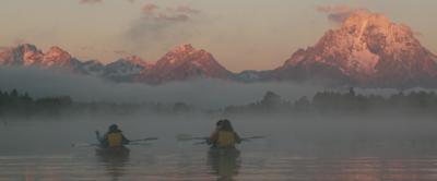 paddling into misty sunrise Tetons: