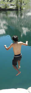 photo by Ethan Wilkie Peter Ye jumps into lake solitude: man jumps from granite rock into lake
