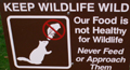 sign keep wildilfe wild: