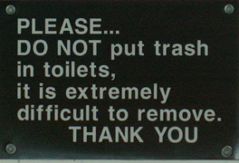 sign please do not put trash in toilets: