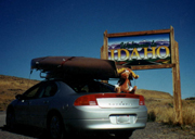 rental car with kayaks loaded on top:
