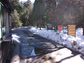 upper pines campground entrance winter 2016: road into a campground with kiosk and signs