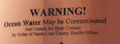 warning beach top words 120 pxls: