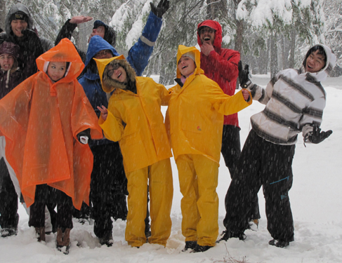 2011 snow camp group photo in campsite: nine people posing for a gorup photo during a heavy snow fall