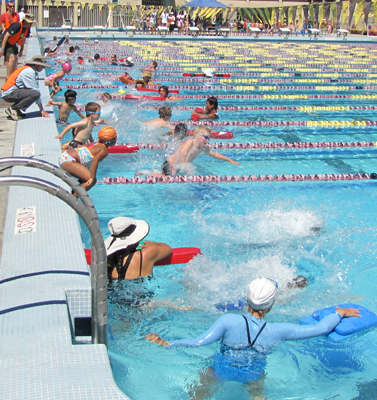 2012 kids tri jumping in: kids jumping into pool at start of swim race