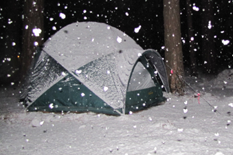 430 a.m. snowfall 2011: big snowflakes are seen falling, lit up by camera flash in front of tent