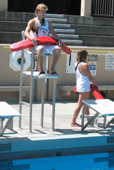 Alanna Klassen and Ethan Wilkie rotate guarding stations 3: one lifeguard in lifeguard stand while other rotates to another station