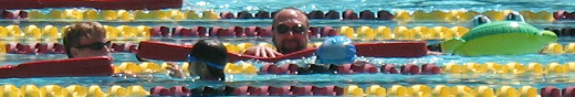 Ethan Wilkie and Ken Mignosa with SVKT swimmers: adult lifeguards swim with child triathletes photo by Alan Ahlstrand, Red Cross Lifeguard Instructor and Volunteer of Record for De Anza College