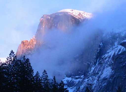 Half Dome from near campsite winter 2011: Half Dome with alpenglow and low clouds