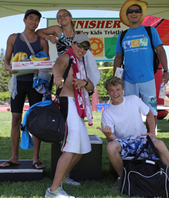 photo by Joyce Kuo lifeguard group photo after the kid's tri: Silicon Valley Kids Triathlon lifeguards Jeremiah Chua, Emily May, Herland Antezana, Ethan Wilkie and Javier Puente pose after the race for a group photo by Joyce Kuo.