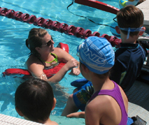 Joelle Cope with swimmers at Kid's tri: Joelle Cope with swimmers at Kid's tri photo by Alan Ahlstrand, Red Cross Lifeguard Instructor and Volunteer of Record for De Anza College