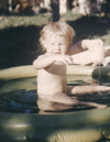 Mary in a wading pool: Mary in a wading pool wearing only a smile.