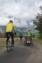 NPS photo biking multi-use path: various cyclists on pathway with mountains in background