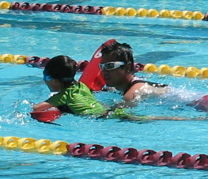 QUANG AND SWIMMER 2010: lifeguard Quang with swimmer at triathlon photo by Alan Ahlstrand