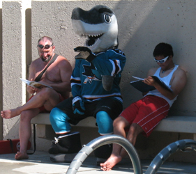 Sharkie, Ken and Quang: lifeguard instructors on a break joined by Shark mascot photot by Alan Ahlstrand, Red Cross Lifeguard Instructor and Volunteer of Record for De Anza College