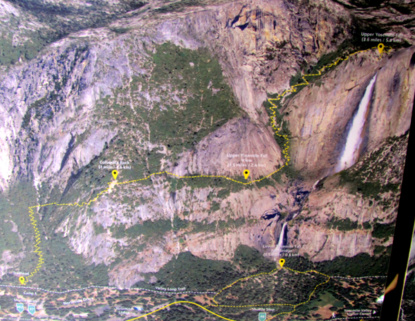 Yosemite falls trail display at visitor center with route.: photo of Yosemite cliffs with Yosemite falls trail outlined