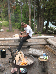 axe as a can opener: a desperate, starving camper (well, maybe not) uses an axe as a can opener at a campsite in the Wyoming wilderness