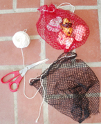 bags for pool toys made from net bags for fruit: two net bags with twine as drawstrings