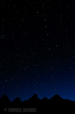 big dipper over the Tetons photo by Enrique Aguirre: mountains with lots of stars above, including the big dipper