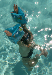 child held under by waterwings: