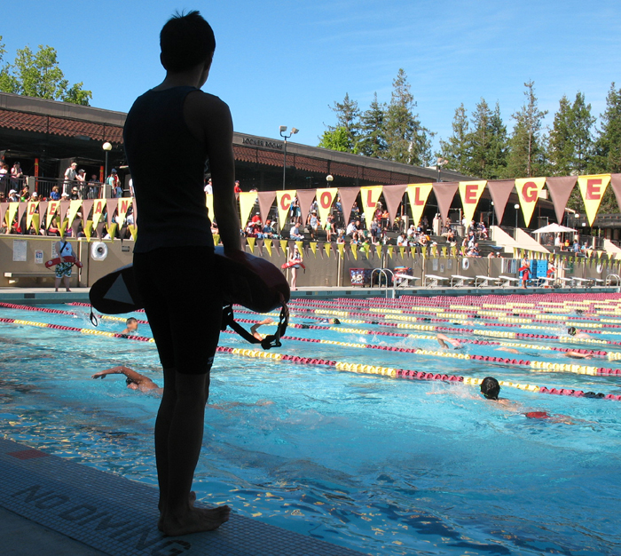 guardingtheSiliconValleyKidstri: lifeguard silhouetted against pool of swimmers photo by Alan Ahlstrand, lifeguard instructor and volunteer of record for De Anza College