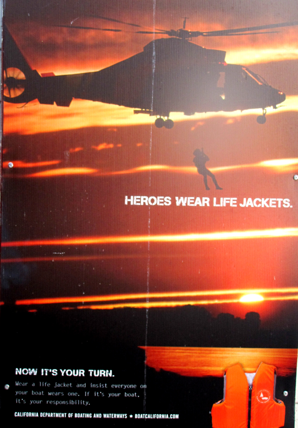 heros wear lifejackets: a poster with a rescuer hanging from a helicopter that says heroes wear lifejackets