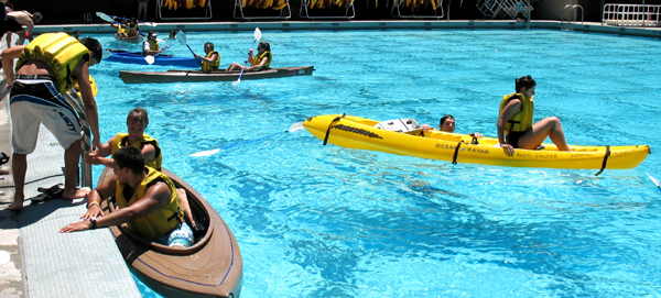 kayak lesson in De Anza college pool 2010: kayakers in and out of the water in an olympic sized pool