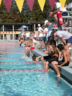 kids tri getting into pool: