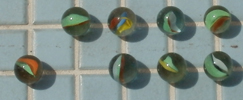 marbles on pool deck: eight marbles on a pool deck