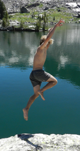 photo by Peter Ye Ethan Wilkie jumps into lake solitude: man jumps from granite rock into lake