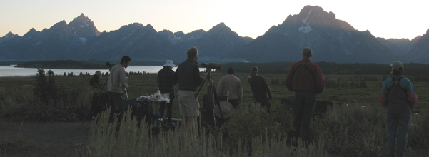 sunset Lunch Tree Hill Sept. 2009: Teton range above Jackson Lake and group of people in the foreground after sunset