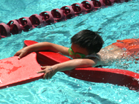 triathlete with kickboard and rescue tube: triathlete with kickboard and rescue tube