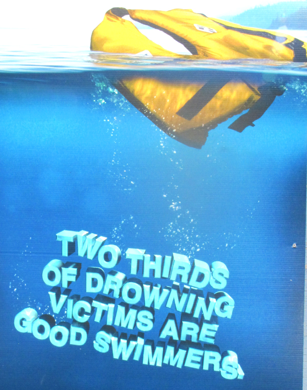 two thirds of drowning victims are good swimmers: poster that says two thirds of drowning victims are good swimmers, showing a lifejacket floating at the surface of the water with bubbles rising from below