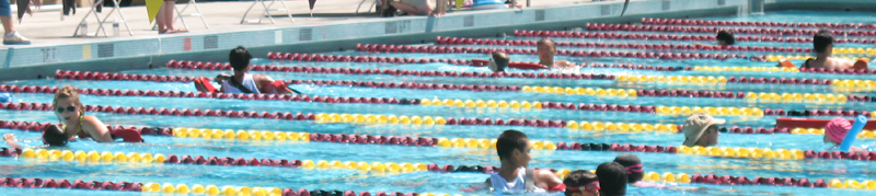 under six many lanes 2010: lifeguards swimming with kids at triathlon photo by Alan Ahlstrand